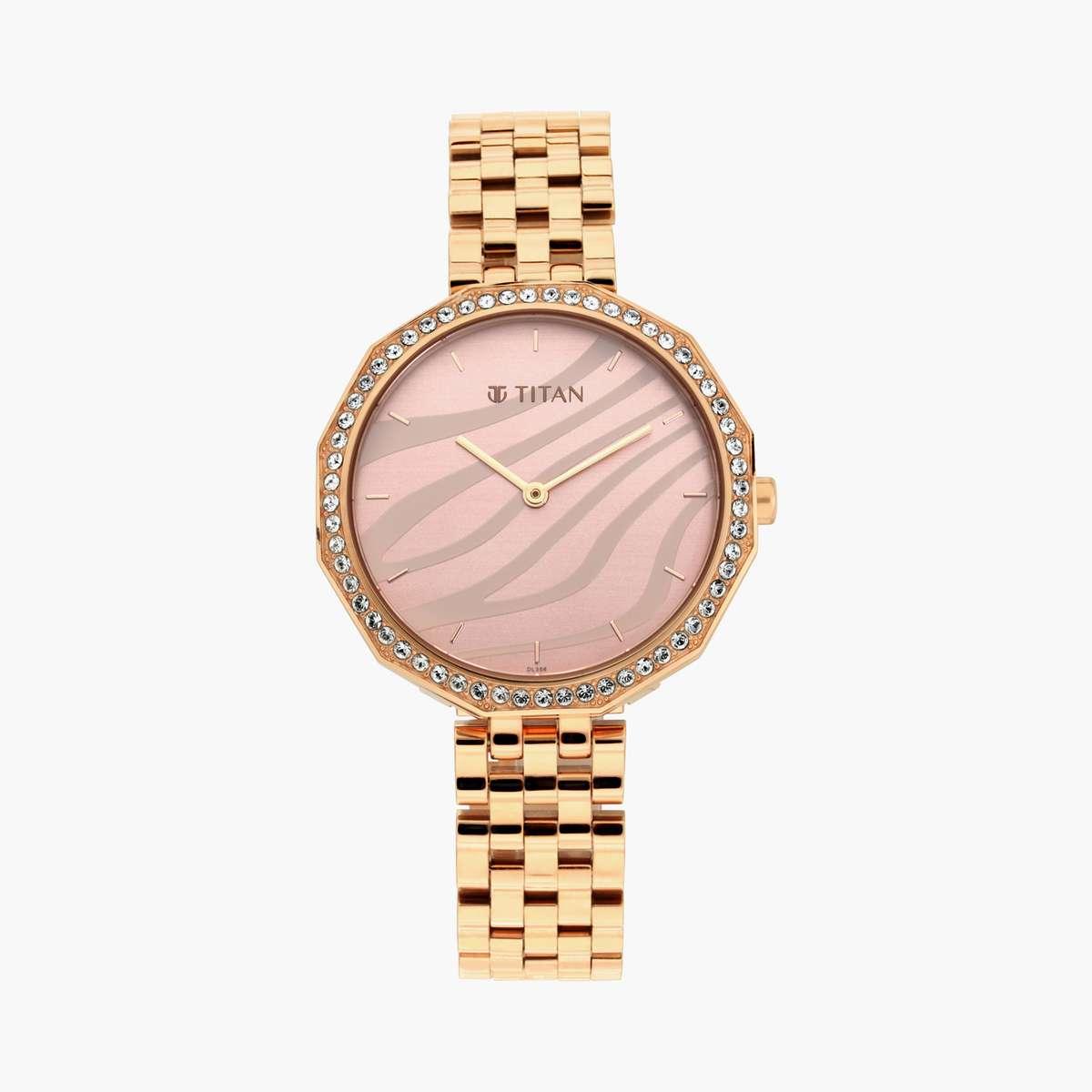5.TITAN Women Embellished Analog Watch- 95132WM01